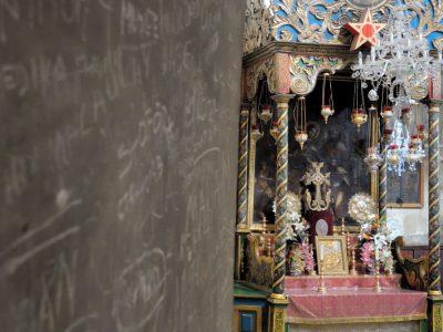 Adorned altar next to graffiti