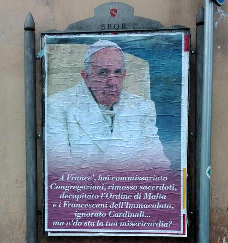 One of the unauthorized bills against the Pope posted in Rome, questioning his decisions and alleged lack of mercy. ANSA/ FRANCESCO GERACE
