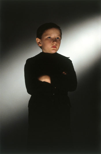 Cold, frightening child. A character from the movie Equilibrium.