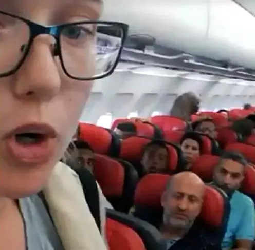 Elin Ersson on a plane, protesting the deportation of an Afghani from Sweden